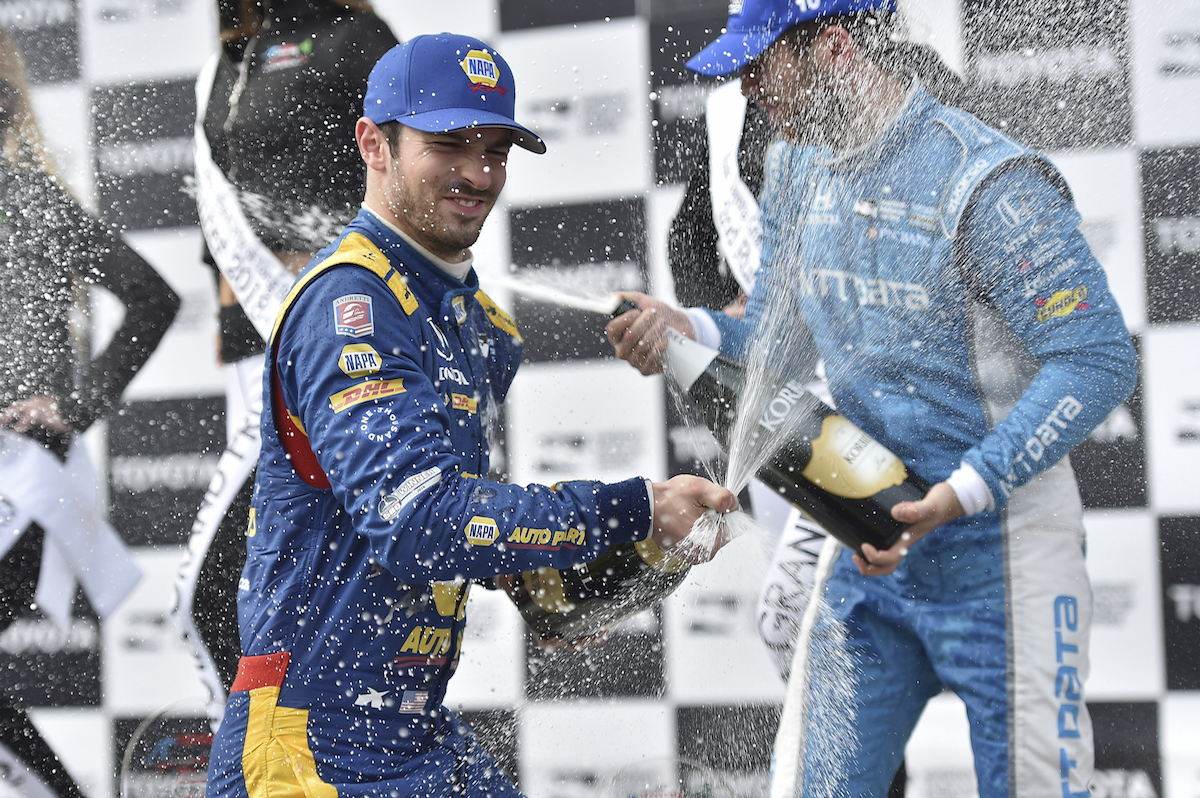 Alexander Rossi sprays the champagne in Victory Circle after winning the Toyota Grand Prix of Long Beach