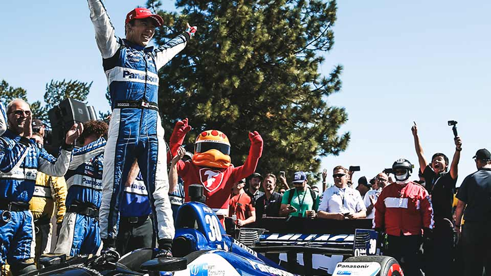 Takuma Sato celebrates his win in Portland