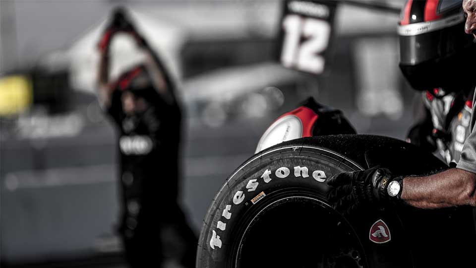 A technician waits to change a Firestone Tire