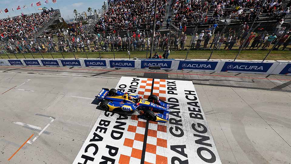 Alexander Rossi races over the finish line at the acura grand prix of long beach