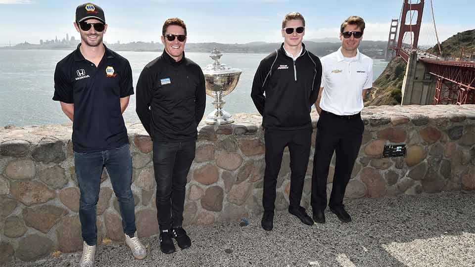 Rossi, Dixon, Newgarden and Power pictured with the Astor Cu